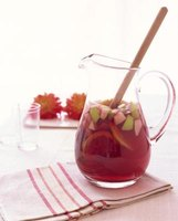 If you want to keep champagne sangria red, add  a bit of  pomegranate juice.