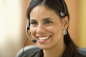 Smiling customer service representative on headset.