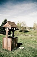 A square wishing well adds a cheerful touch to your lawn.