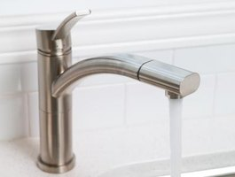Your kitchen faucet can supply water to your portable washer.
