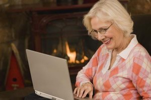 A mature woman on the computer.