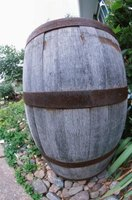 Use gravity to move water from a rain barrel to a water feature.