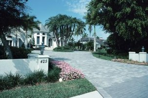 Recycled asphalt gravel is an inexpensive, fairly durable driveway overlay.