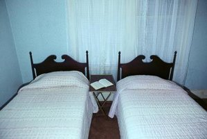 Two twin beds can form a king bed.