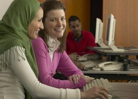 Students preparing for TOEFL exam in computer lab.