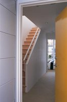 Create an open staircase out of a closed staircase by making a short wall.