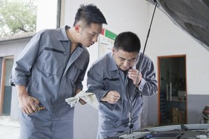 Mechanics looking at an engine.