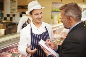 Butcher shop owner meeting with a potential investor