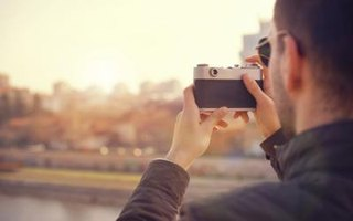 Image of someone taking a photograph.
