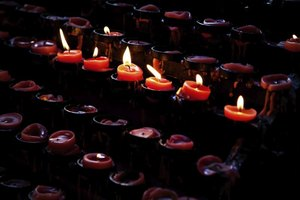Candles lit in church.