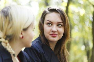 A teenager listening to her friend disclosing something unexpected.