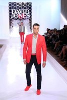 Designer David Jones showcases red suede loafers on the runway.