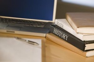 Close-up of history book besides a laptop.