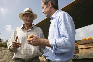 Secretary of agriculture speaking with farmer.