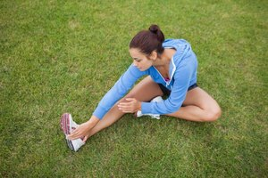 Woman stretching on grass.