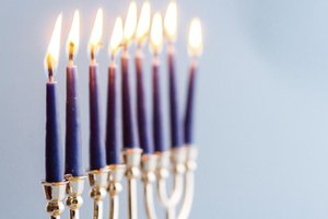 A close-up of a lit Menorah.