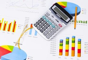 A graph, calculator and pencil are arranged together over an investment portfolio