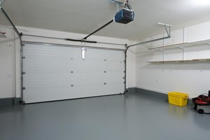 Clean garage with painted concrete slab floor.