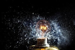 A power surge can cause a light bulb to explode.