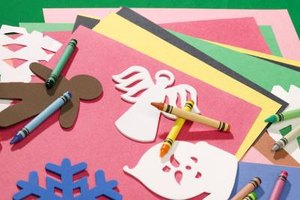Embellish your scrapbook with foam shapes and crayon drawings.