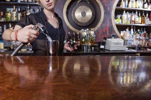 A bartender making a drink.