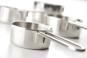 You can usually remove heat stains and other dark spots from stainless steel cookware.