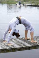 Practice backbends to stimulate your thyroid gland and increase energy.
