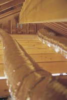Installing subflooring over attic rafters is a relatively easy DIY project.
