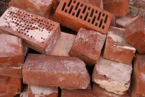 Bricks are a sturdy, attractive medium from which to build outdoor planters.