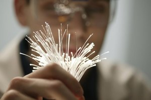 A technician holds fiber optic cables