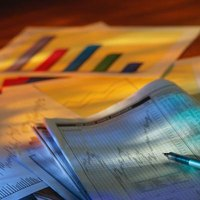Financial analysts spend long hours studying financial reports and preparing reports.