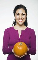 Pumpkins can be decorated like a cheerleader simply by adding a little team spirit.