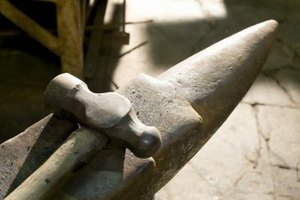The hammer and anvil are common blacksmith tools.