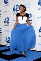 "Naturi Naughton wears peep toes with her maxi skirt at the ""42"" movie premiere in Los Angeles, California in 2013."
