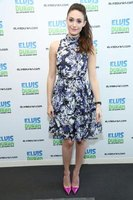 Emmy Rossum wears pumps with her flowery dress at the Z100 Studio in New York City in 2013.