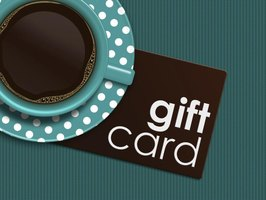 Gift card next to a cup of coffee