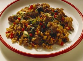 Combine toasted brown rice with meat and vegetables for an easy dinner.