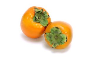 Select persimmons that are unblemished, with shiny skin.