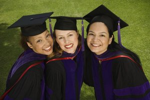 Three female student graduates