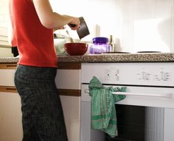 Woman prepping food beside oven