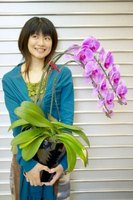A woman and her orchid -- priceless.