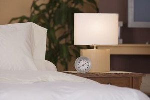An uncluttered nightstand is key to not knocking things over at night.