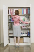 A basic storage cabinet, faced with a door, is invaluable in any room.