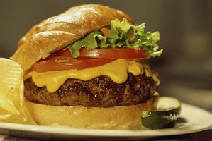 Top a beef patty with lettuce, tomatoes and cheese to make a classic cheeseburger.