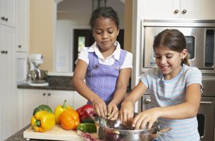 Children cooking in a kitchen together.