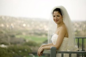 Make the most of your bridal hairstyle with a properly placed veil.