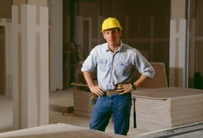 Construction worker with drywall