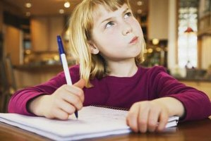 A young girl thinking about how to approach a homework assignment.