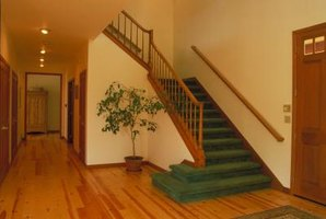 Hand rails can be installed along hallways walls much the same as they are along stairway walls.