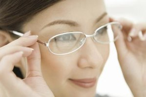 Optometric assistants fit and adjust eyeglasses.